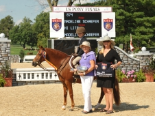 "Hi Light and Madeline Scahefer won the small pony hunter title at <a href=""article/hi-lite-stands-out-usef-pony-finals"">USEF Pony Finals.</a>"