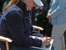 Kim Signs Autographs