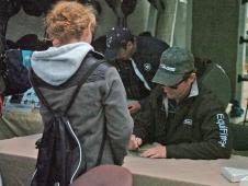 Phillip Signs Autographs