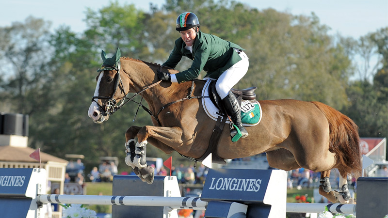 Cian O'Connor celebrated mid-air as he clinched Team Ireland's win in the $100,000 FEI Nations Cup at HITS Ocala. Photo by Molly Sorge