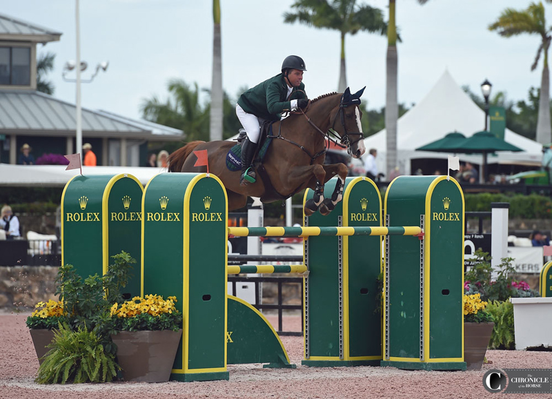 Cian O'Connor and Seringat over the last fence of the $216,000 Lugano Diamonds Grand Prix. Photo by Ann Glavan