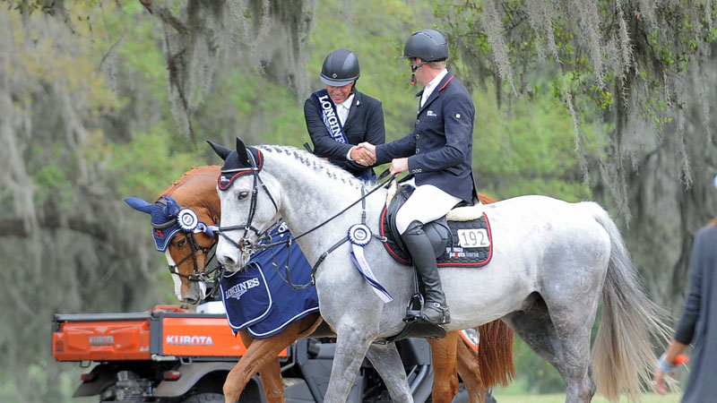 Todd Minikus and Andre Thieme shook hands after finishing one-two in the $100,000 Longines FEI Ocala World Cup Qualifier. Photo by Ann Glavan