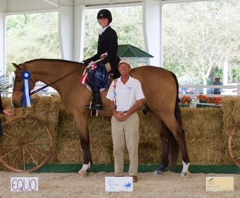 George d'Ambrosio of The Ridge Palm Bach Series (right) congratulated Hallie Buttenwieser and Wanderlust on their win in the $5,000 USHJA National Hunter Derby. Photo by Equinium Sports Marketing