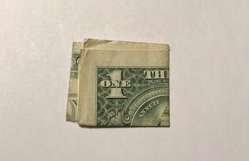 A photo of the actual dollar bill, taken by Durand and included in his Facebook post with the story.