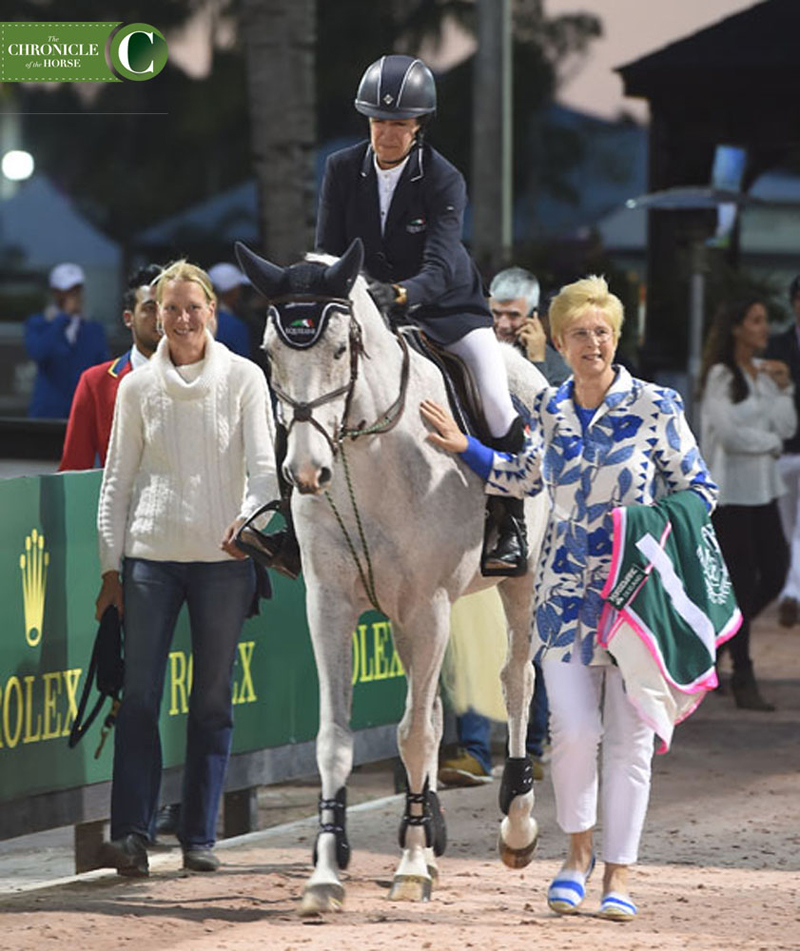 Laura Kraut rode Cedric into the ring for the last time, accompanied by his groom Johanna Burtsoff (left) and his owner, Margaret Duprey (right). Photo by Ann Glavan