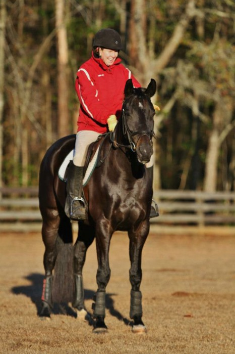 "These days, Elizabeth Barron doesn't compete with ""Cleo,"" but she still takes lessons and works on improvements at both jumping and dressage. Photo courtesy Elizabeth Barron."